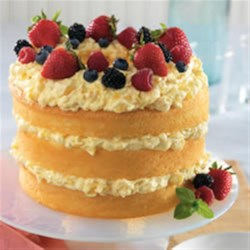 Angel Lush with Pineapple from DOLE(R) Recipe - Layers of angel food cake are spread with a creamy vanilla mixture and topped with fresh berries.