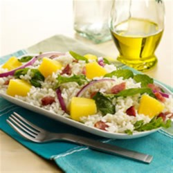 California Rice Salad Recipe - Great for a pot luck, picnic, or a barbecue, this rice salad with pineapple, arugula, and crumbled bacon will be a favorite.