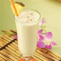 Creamy Pineapple Shake Recipe - Crushed pineapple, vanilla ice cream, milk, and a dash of cinnamon blend into a cool, refreshing shake.