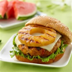 Teriyaki Pineapple Turkey Burgers from DOLE(R) Recipe - Ground turkey burgers with a hint of fresh ginger and teriyaki sauce are grilled and served on buns with grilled pineapple and a slice of Cheddar.