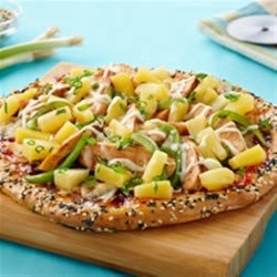 Sweet Sesame Chicken Pizza Recipe - Plum sauce, sesame seeds, Thai sweet chili sauce, and pineapple bring a sweet Asian-inspired twist to this chicken pizza.