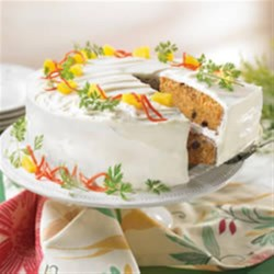 Fabulous Carrot Cake Recipe - This carrot cake recipe delivers a moist cake with lots of shredded carrots, crushed pineapple, and raisins and a tangy lemon cream cheese frosting.