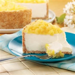 Pina Colada Cheesecake Recipe - The pineapple, rum, and coconut flavors of your favorite cocktail are mixed into this creamy, delicious cheesecake.