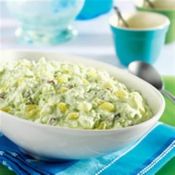 Watergate Salad from DOLE(R) Recipe - This dessert salad with a pistachio pudding base contains crushed pineapple, miniature marshmallows, pecans, and whipped topping.