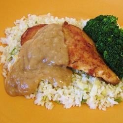 Chicken with Rice and Gravy Recipe - Chicken breasts are seasoned and fried, then served with rice and a creamy gravy. A family original, my family members request this all the time!!