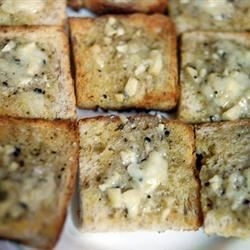 Garlic Bread Fantastique Recipe - A mixture of butter, mayonnaise, garlic, sage and oregano is spread on a baguette. Lightly toast the baguette under the broiler, and enjoy with any meal!