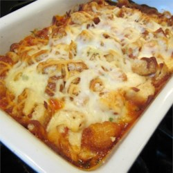 The Best Parmesan Chicken Bake Recipe - This chicken Parmesan is done casserole style (so, no breading or frying!), but still offers up that irresistible combination of tender chicken, crunchy/cheesy coating, and flavorful sauce.