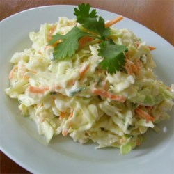 Cilantro-Lime Coleslaw Recipe - A versatile cabbage slaw with mayonnaise, lime zest, and cilantro makes a great side dish for all kinds of foods, from Asian to Mexican-inspired dishes.