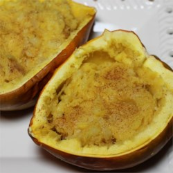 Pineapple Cinnamon Stuffed Acorn Squash Recipe -  The hardest part of this recipe is cutting the squash in half and scooping out the seeds. The rest is a snap. Cook the squash, scoop out pulp and mix with pineapple and yummy spices. Stuff the squash and pop into the oven again until bubbly and fragrant.