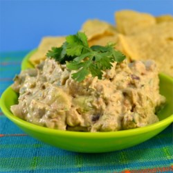 Bacon Avocado Cream Cheese Dip Recipe - Cream cheese, salsa, and bacon come together in a dip topped with avocado perfect for Mexican-inspired parties.