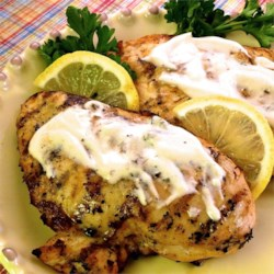 Grilled Lemon Yogurt Chicken Recipe and Video - This tangy lemon-yogurt chicken is grilled to caramelized perfection over a charcoal grill.
