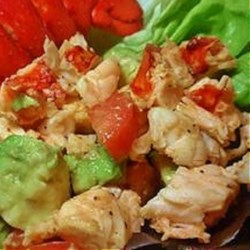 Avocado and Lobster Salad Recipe - This salad combines warm lobster chunks with tomato and avocado, sprinkled with crumbled feta cheese.