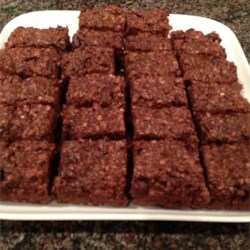 Breakfast Brownies Recipe - Bake oats, flax seed meal, and mashed bananas together to create a hearty, breakfast brownie perfect for all your family members.