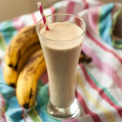 Peanut Butter Banana Smoothie Recipe - Bananas, milk, peanut butter, honey, and ice are all you need to make this filling yet refreshing smoothie.