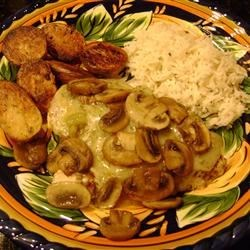 Baked Havarti Chicken Recipe - Baked chicken breasts marinated in Italian dressing and Greek seasoning, topped with Havarti cheese, green chili pepper, and sauteed mushrooms. Pairs beautifully with long grain rice and steamed vegetables.
