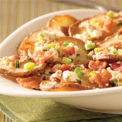 Pan-Fried Greek Potatoes Recipe - Thinly sliced potatoes are pan fried in bacon drippings, and served with crumbled bacon, sliced green onions, and lots of feta cheese with basil and tomato.