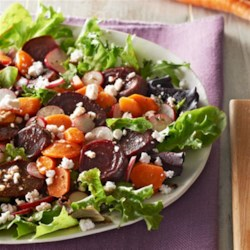 Roasted Beet and Carrot Salad Recipe - Roasted beets and carrots are served on mixed salad greens with balsamic vinaigrette and topped with sliced radishes and crumbled feta cheese.