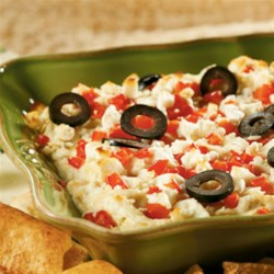Layered Hot Artichoke and Feta Dip from ATHENOS Recipe - This hot layered dip has one delicious ingredient after another: Neufchatel and Parmesan cheeses, artichokes, garlic, red pepper, olives . . . Need we say more?