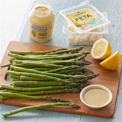 Asparagus Salad with Lemon and Feta Recipe - Crisp-tender asparagus spears are drizzled with a lemon mustard vinaigrette and topped with crumbled feta cheese and lemon zest.
