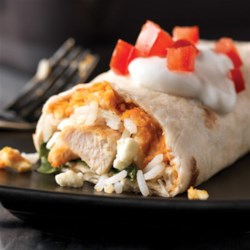 Greek-Style Burritos Recipe - Chicken burritos with rice, lemon zest, hummus and spinach are a tasty variation on traditional flavors and ingredients.