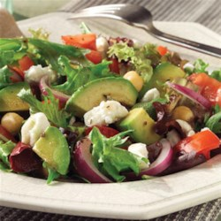 Mediterranean Salad with Feta Cheese Recipe - This refreshing, summery salad combines mixed greens with tomatoes, kalamata olives, avocado, garbanzo beans, and avocado.