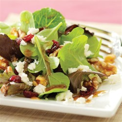 Cranberry and Feta Salad with Dijon Vinaigrette Recipe - Ready to serve in minutes, this mixed greens salad with walnuts, feta cheese, and dried cranberries is tossed with a Dijon mustard vinaigrette.