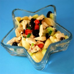 Chicken and Vegetable Pasta Salad Recipe - Choose a pretty pasta  - bow tie, penne or rotini. That 's half the fun in making this salad. A nice Italian dressing adds plenty of zip, and the only thing left is tossing in the chicken, green onions, olives and a few cucumbers.