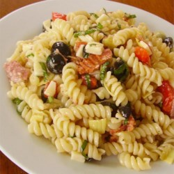 Quick Antipasto Pasta Salad Recipe - Fusilli pasta is tossed with salami, roasted red peppers, and artichoke hearts creating an Italian-inspired antipasto salad for a delightful addition to picnics and parties.
