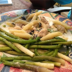 Chicken Asparagus Pasta with Cream Sauce Recipe - This quick and easy pasta is tossed with chicken and homemade cream sauce. Asparagus and Parmesan cheese add a nice color and flavor.