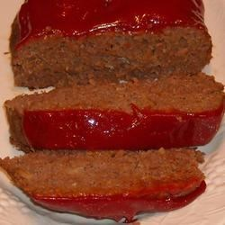 Ann's Sister's Meatloaf Recipe Recipe - This down home meatloaf mixture includes beef, eggs, dry bread crumbs, ketchup and dry onion soup mix - all topped with bacon and tomato sauce and baked into the loaf that it is.