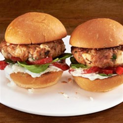 Mediterranean Turkey Sliders Recipe - Miniature turkey patties are flavored with ATHENOS Feta Cheese and sun-dried tomatoes, then topped with spinach, roasted red peppers and a flavorful tzatziki sauce. Serve them as part of a meal or as a party appetizer.