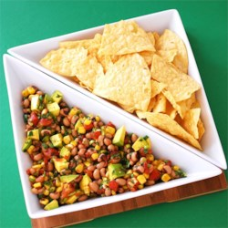 Avocado and Black Eyed Pea Salsa Recipe - Serve this festive, colorful salsa salad, made with black-eyed peas, avocado, and white shoe peg corn, with chips or as a side dish. It's perfect for New Year's or watching football.