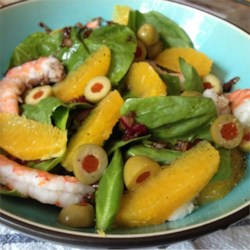 Orange Shrimp Spinach Salad Recipe - Cooked shrimp combine with fresh oranges, black olives, and baby spinach leaves for a unique salad that makes a great light lunch. Dressing is just a simple drizzle of olive oil and balsamic vinegar.