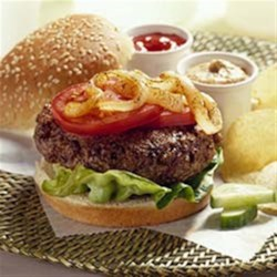 Burgers with Grilled Onions Recipe - All-American hamburgers get a tasty topping of grilled sweet onions, fresh lettuce, and tomato slices in this classic recipe.
