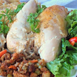 Roast Chicken with Croutons and Onions Recipe - A roast whole chicken made in a cast iron skillet is surrounded by chunks of onion and French bread that catch all the delicious drippings. Be sure to serve the onion and bread cubes with the sliced chicken meat.