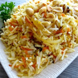 Carrot Rice Recipe - Fragrant basmati rice sauteed with carrots, onions, fresh ginger, peanuts, and cilantro.