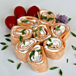 Burrito Canapes Recipe - Tortillas are rolled around a spicy cream cheese filling and sliced into small rounds for a fun and easy appetizer.