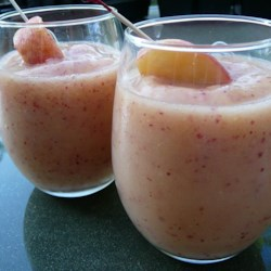 Grandmother's Peach Fuzz Recipe - Limeade, rum and fresh peaches blend into a velvety summer drink. It cannot be made virgin, the rum is the key ingredient! The peach skins add a lovely bit of color.  Canned peaches do not work as well.