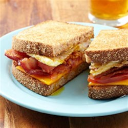 Bacon and Tomato Fried Egg Sandwiches with Horseradish Mayo Recipe - Breakfast sandwiches with bacon, eggs over easy, cheese and tomato get an extra kick with horseradish mayo.