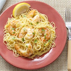 Garlic Shrimp Scampi with Angel Hair Pasta Recipe - Marinated in olive oil, wine, garlic, and lemon zest, large shrimp are quickly pan fried in hot butter, simmered briefly, and tossed with angel hair pasta.