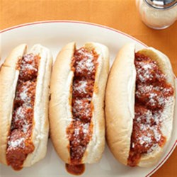 Marinara Meatball Subs Recipe - Baked meatballs are simmered in marinara sauce and served up in toasted hoagie buns.