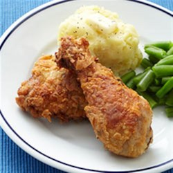 Southern-Style Fried Chicken with Garlic Mashed Potatoes Recipe - Brined in buttermilk, this fried chicken is tender and moist and, served with garlic mashed potatoes, a sure-fire family favorite.