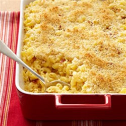 Three-Cheese Mac and Cheese Bake Recipe - Shredded Cheddar, provolone, and Asiago make this mac and cheese with bacon a triple cheese-y comfort food.