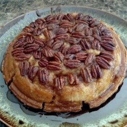 Topsy-Turvy Apple Pie Recipe - For this clever creation, butter and pecans are put into the pie pan before the bottom pastry. After the pie is completely filled with sweet, spiced apples, topped with a second crust and baked, the entire pie is flipped to reveal a luxurious pecan glaze.