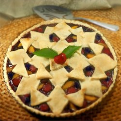 Cherry Berry Peach Pie Recipe - Use your summer peaches, blueberries, and cherries to create a colorful lattice-top pie to enjoy with a scoop of vanilla ice cream on a hot summer evening.