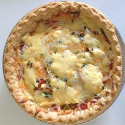 Summer Tomato Pie Recipe - Tomato slices are layered with Cheddar and mozzarella cheese, basil, and garlic for a savory summer pie. It is a great way to use up all those extra tomatoes from the garden!