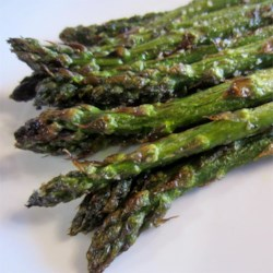 Grilled Asparagus Recipe and Video - Asparagus is grilled with a little oil, salt, and pepper for a simple summer side dish.