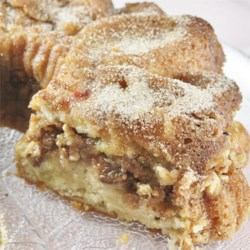 Filled Rhubarb Coffee Cake Recipe - A lovely rhubarb cake baked in a fluted tube pan has a crunchy, sweet layer of walnuts and brown sugar in the middle.