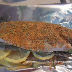 Mountain Trout Recipe - Fresh trout dredged in herb-seasoned flour are simply grilled to perfection with lemon and slivered almonds.