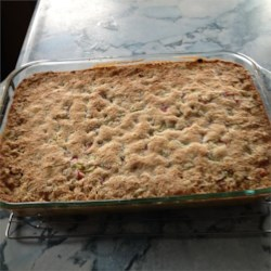 Grandma Bev's Rhubarb Dessert (Rhubarb Crisp) Recipe - A sweet rhubarb filling is baked on a buttery crust creating a bubbling rhubarb crisp just like grandma used to make.